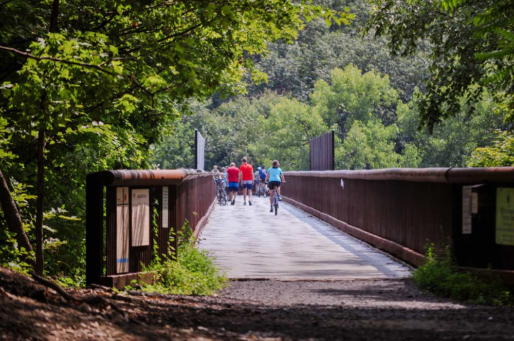 People biking in Rosendale on a bridge
